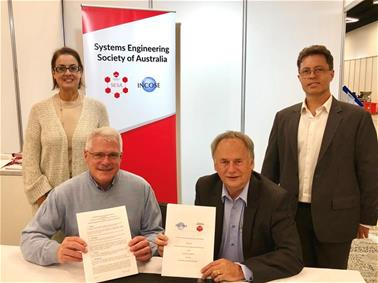 Signing ceremony between the International Council on Systems Engineering, Systems Engineering Society of Australia and Engineers Australia.